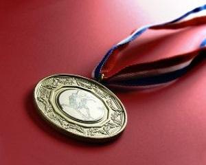 Elevul de pe locul I la olimpiadele scolare internationale va primi un salariu de baza minim brut